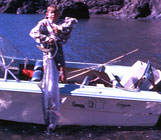 Thats me struggling to hold up a large Kingi caught at the Noises in the early 70s.